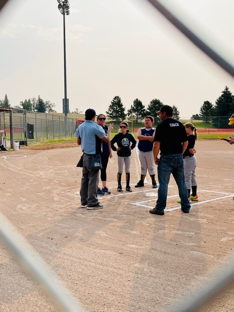 Laramie Girls Softball meet at the plate